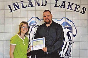 SFT Board member Jason Woider-ski (right) presents a $500.00 schol-arship to Alisha Anderson (left) from Inland lakes High School.