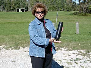 Brenda Archambo holding a telemetry receiver deployed in Black Lake.